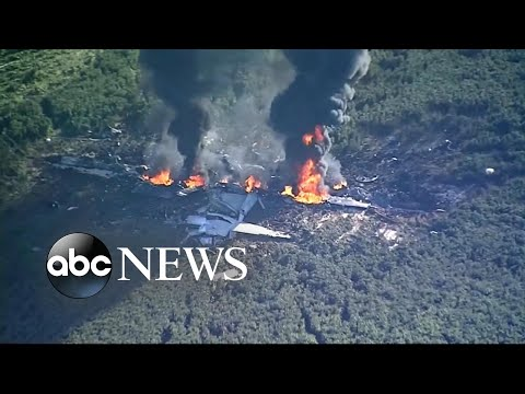 Military cargo plane crashes in Mississippi field