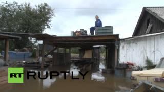 Russia: Burst dam leaves 900 residents homeless