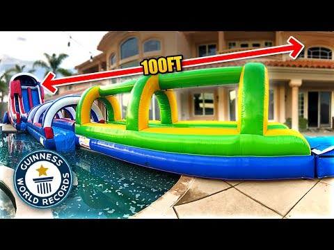 *WORLD RECORD* LONGEST BACKYARD SLIP 'N SLIDE EVER!! (100+ ft)