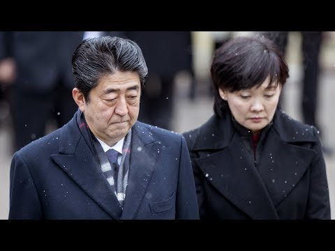 Japan's Abe under fire over suspected scandal