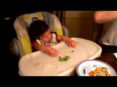 LukeWyatt -First time eating on his high chair.