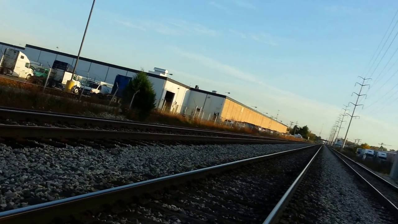 HARBOR freight and CSX freight trains passes by one by one ...