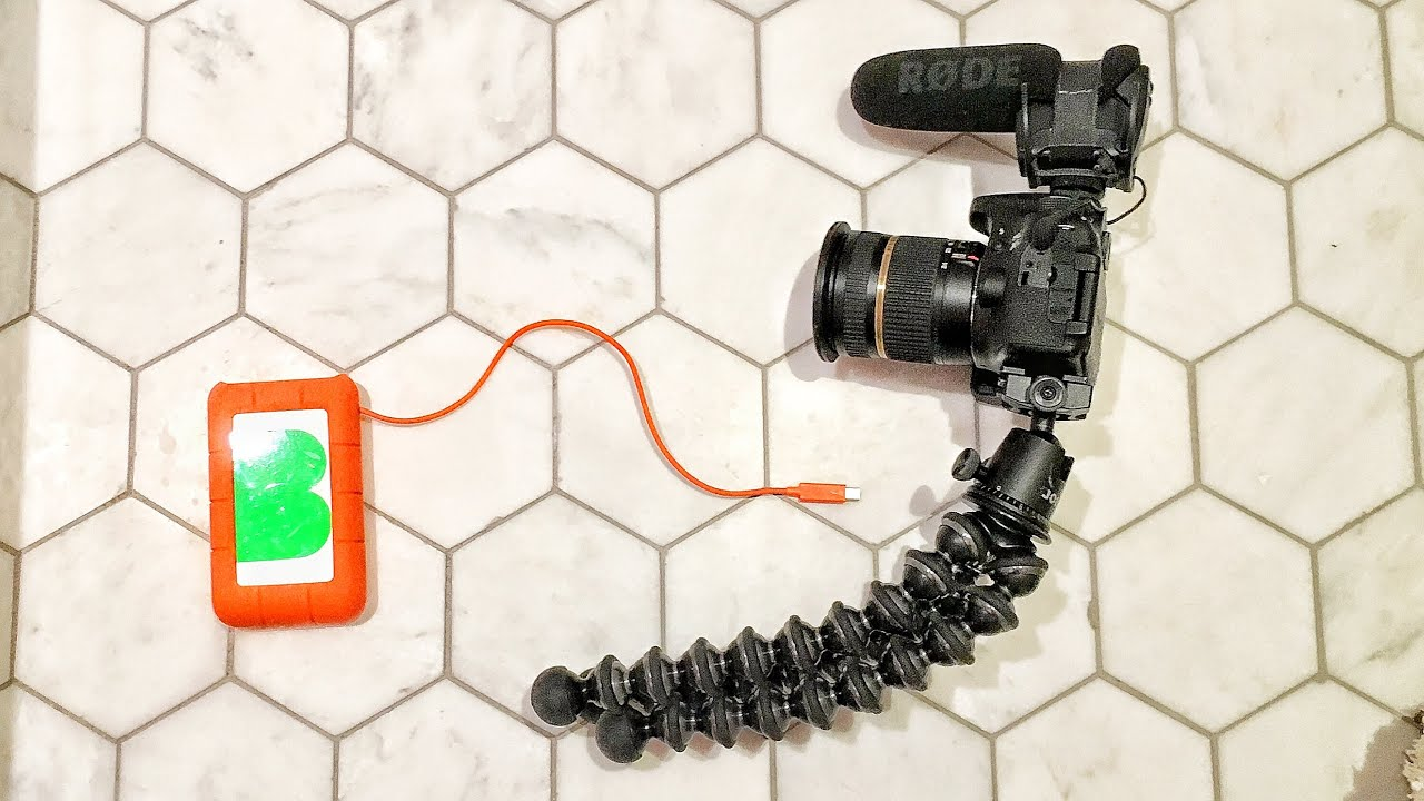 Having a bendy tripod, or even a monopod, would really help distance himself from the camera. This 'look' however is basically patented to famous vlogger Casey Neistat