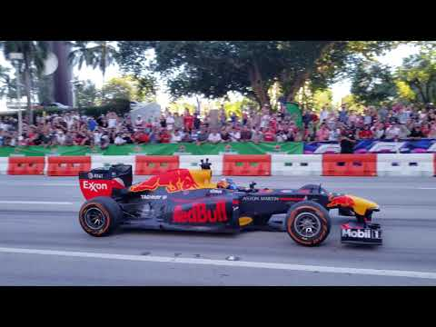 F1 cars roaring on Miami Streets