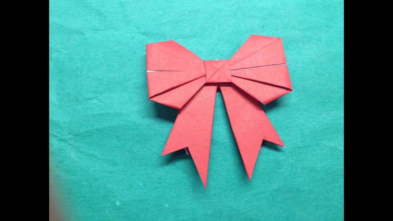 How to fold a paper bow ribbon the art of paper folding for Craft work with paper folding