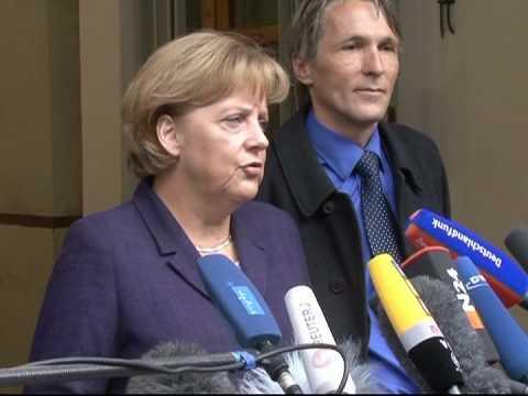 Merkel visits grim ex-Stasi prison in Berlin