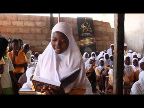 African girl reads quran