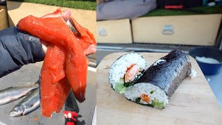 Teriyaki Salmon sushi burrito on my tailgate (Truck Catch and Cook)