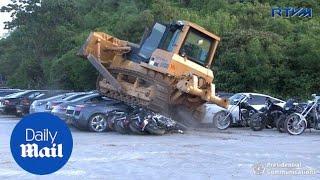 President Duterte looks on as luxury cars get destroyed