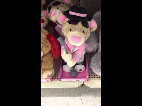 Singing plush bear with white suite on
