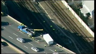Raw Video: Dangling Truck Pulled Back Onto Southeast Expressway