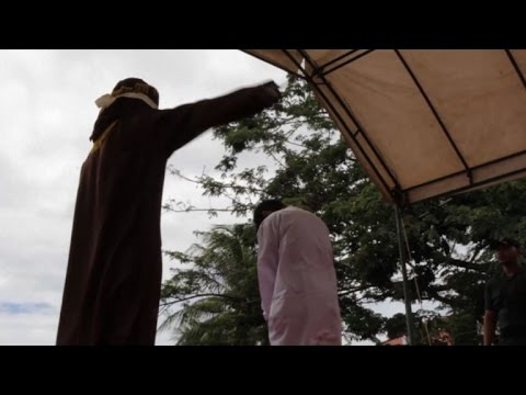 Indonesian men caned for gay sex before jeering crowd