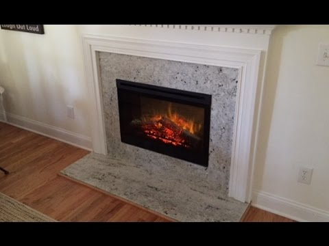 "Gas To Electric Conversion accented with Colonial White Granite Surround This 33"" electric fireplace offers a 120 volt widescreen firebox fan forced controll..."