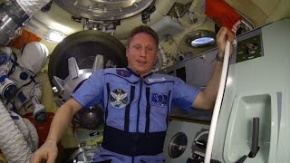 Cosmonaut shows space station hole to calm public