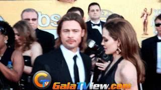Angelina Jolie showed her tattoos & Brad Pitt looked jealous!!