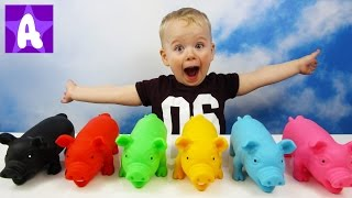 Funny Alex playing and Learns colors with colored Piggy toys