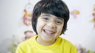 Adorable handsome Indian boy looking into the camera with a joyful smile - naughty expression