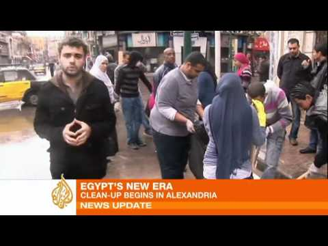 Protesters clean Alexandria streets