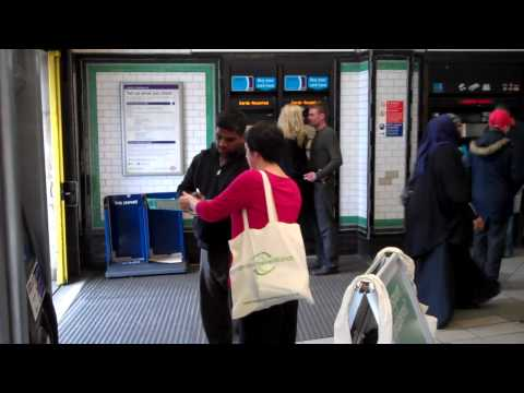 London TravelWatch staff speak to transport users at Tooting Broadway Station