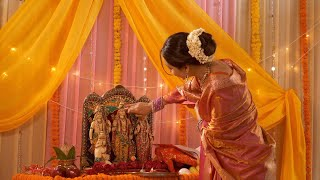 Indian woman applying tika to Hindu God idols - Rama, Lakshmana, Hanuman, Sita in mandir