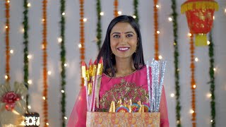 A young attractive woman posing with a collection of crackers for Diwali festival