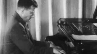Shostakovich plays a fragment of his 7th symphony (1941)