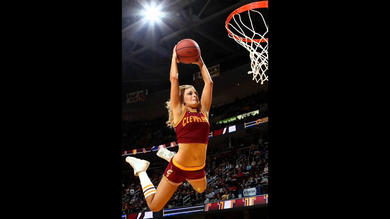 Female basketball player dunking
