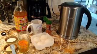 Apple cider vinegar with turmeric and ginger drink