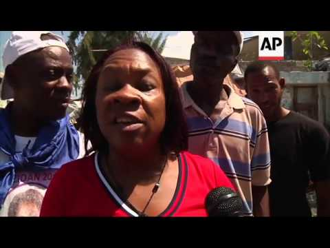 Haitians protest on coup anniversary