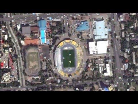 Приближение со спутника до центрального стадиона Алматы.