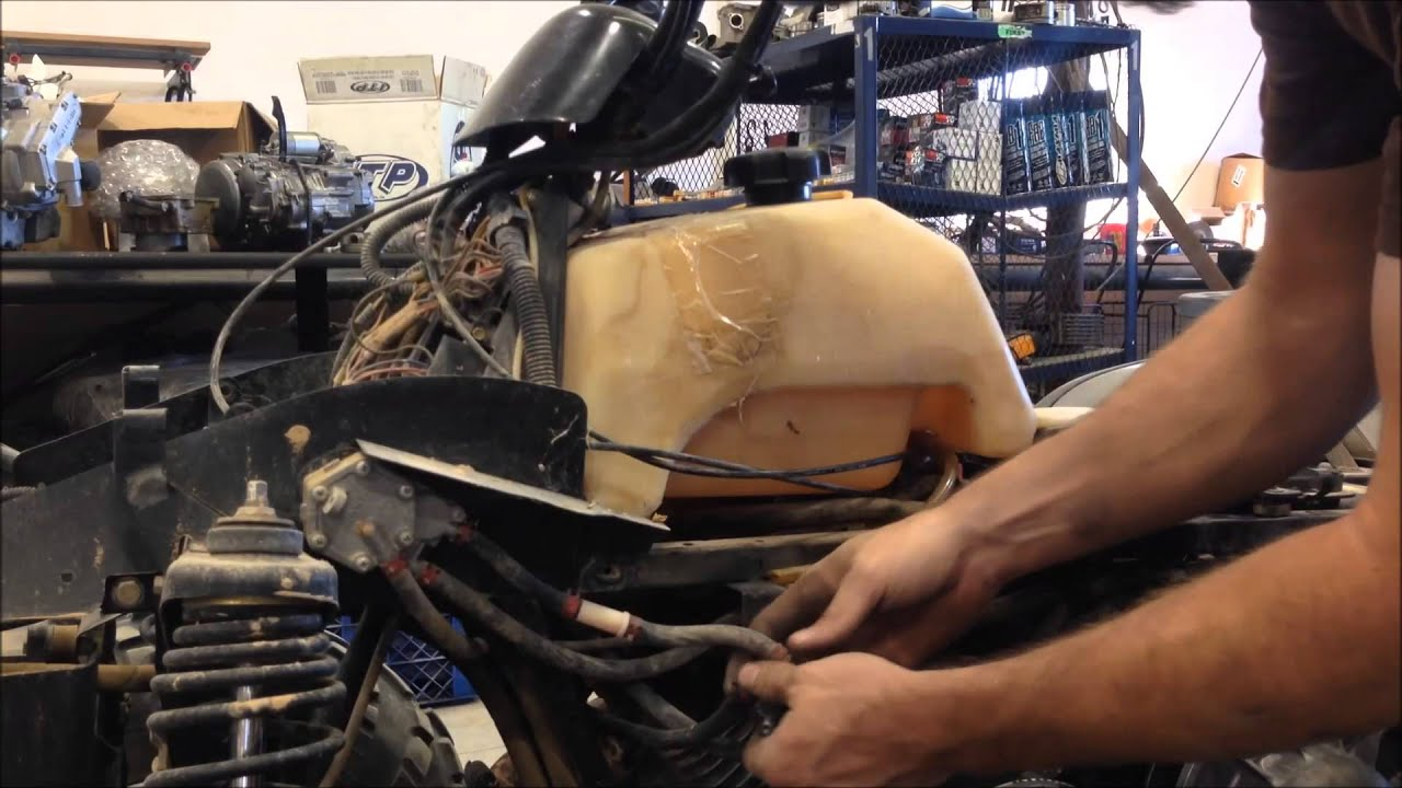 how to clean the carburetor on a polaris magnum 325