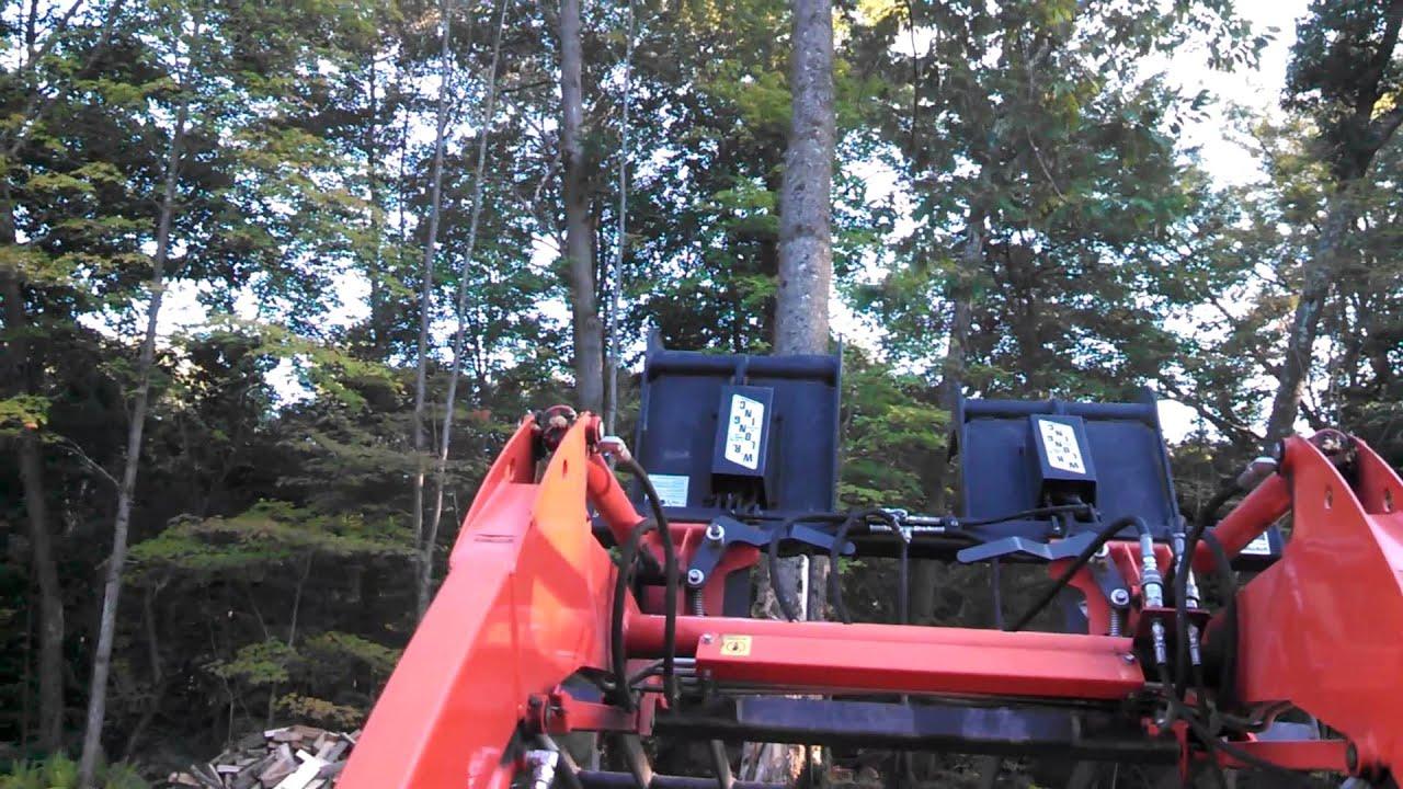 Kubota L3800 pushing over tree