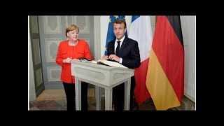 News Merkel, Macron back euro zone budget in 'new chapter' for bloc