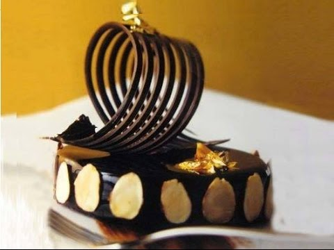 Come realizzare decorazioni in cioccolato fatte in casa - Decorazioni torte con glassa ...