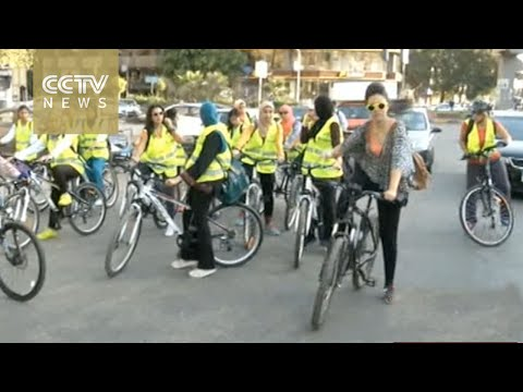 Egypt women on bicycles travel around Cairo provide hot meals for poor
