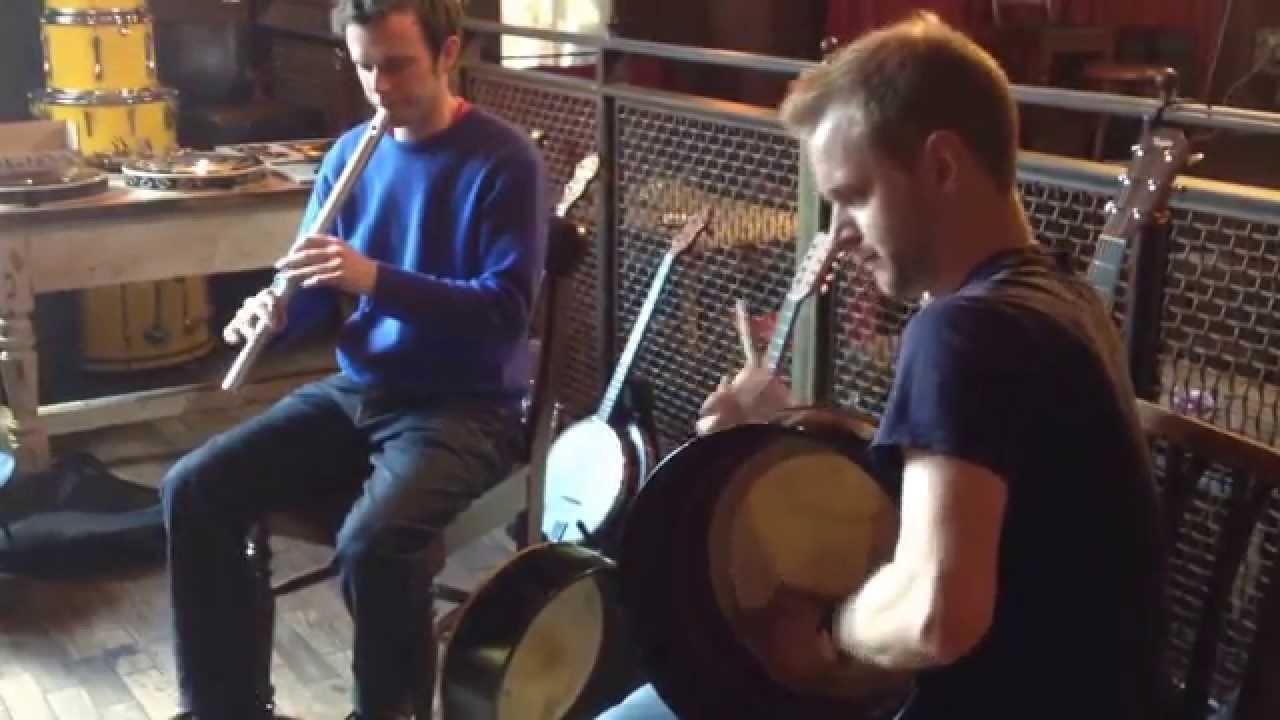 Karl Nesbitt playing the low whistle and Brian O'Hanlon playing the bodhrán.