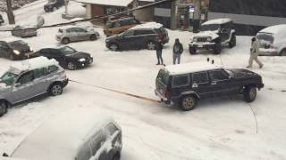 Jeep Cherokee XJ pulling on an icy road a Bmw X3 stuck in snow