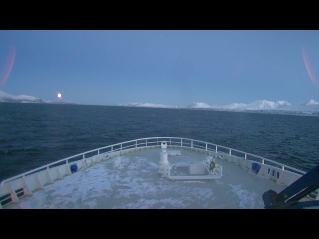 Relaxing real-time footage of ship going towards the Barents Sea during full moon.