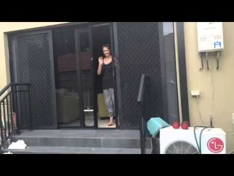 patio pet door insert installed in double sliding doors