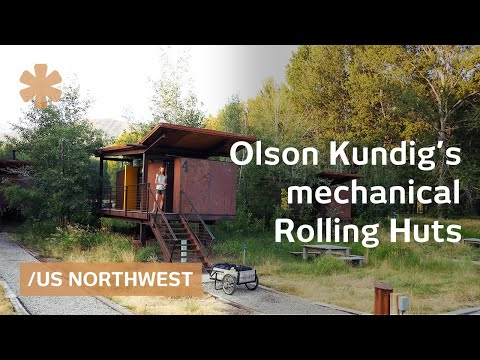 Rolling huts: metal-clad tiny wheeled homes move on a meadow