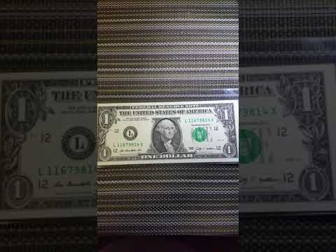 $1 US bank note with X at the end of the serial number
