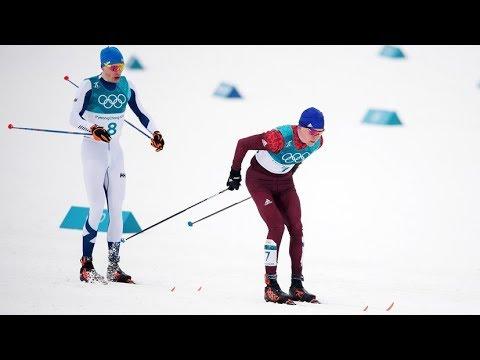Финиш лыжников Ийво Нисканена и Александра Большунова на дистанции 50 км