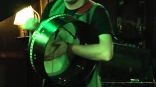 Man Playing Bodhrán (Irish Drum)