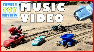 Cars 3 Toys & DinoTrux MUSIC VIDEO - Ponchy Wipeout VS Lightning McQueen Racing Disney Cars at Beach