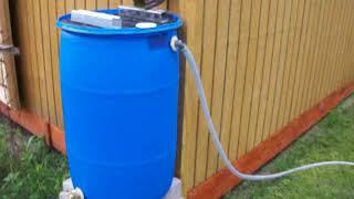 rain barrel setup overflow hose and wind chimes