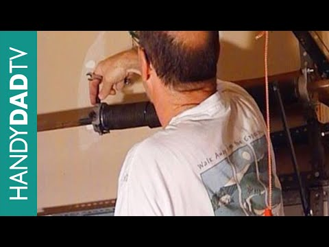 How to Replace a Garage Door Torsion Spring