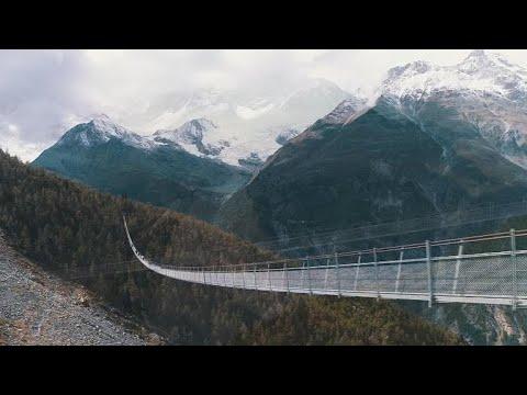 Longest pedestrian suspension bridge soars over Swiss Alps valley