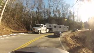 Horse Trailer runs sports cars off the Tail of the dragon TN.