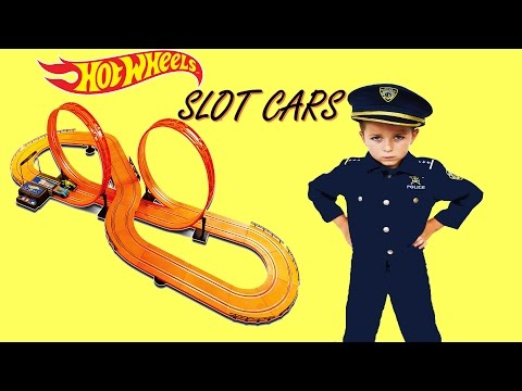 Bad Noisy SANTA delivers Kid Cops HOT WHEELS SLOT CAR TRACK Set