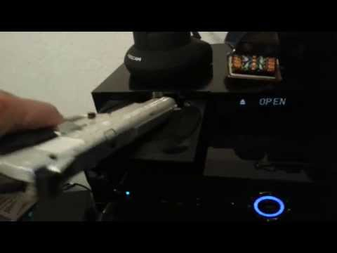 How to clean your DVD player  with a GUN